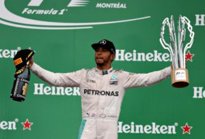 MONTREAL, QC - JUNE 12: Lewis Hamilton of Great Britain and Mercedes GP celebrates winning the Canadian Formula One Grand Prix at Circuit Gilles Villeneuve on June 12, 2016 in Montreal, Canada. Mark Thompson/Getty Images/AFP == FOR NEWSPAPERS, INTERNET, TELCOS & TELEVISION USE ONLY ==